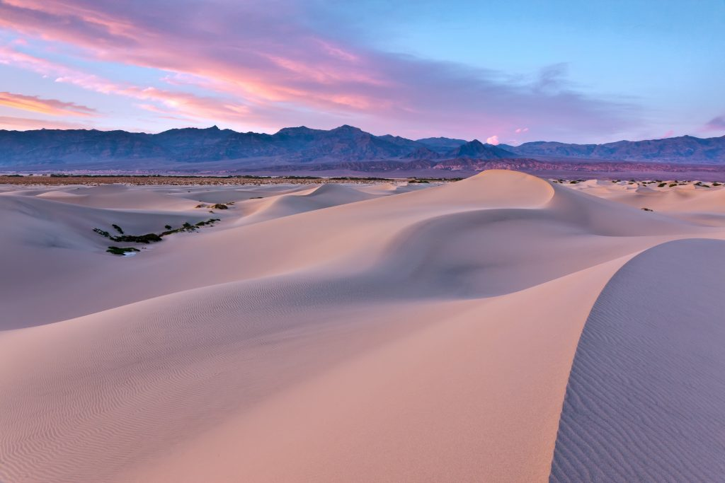 mesquite dunes in death valley national park during a pink sunrise