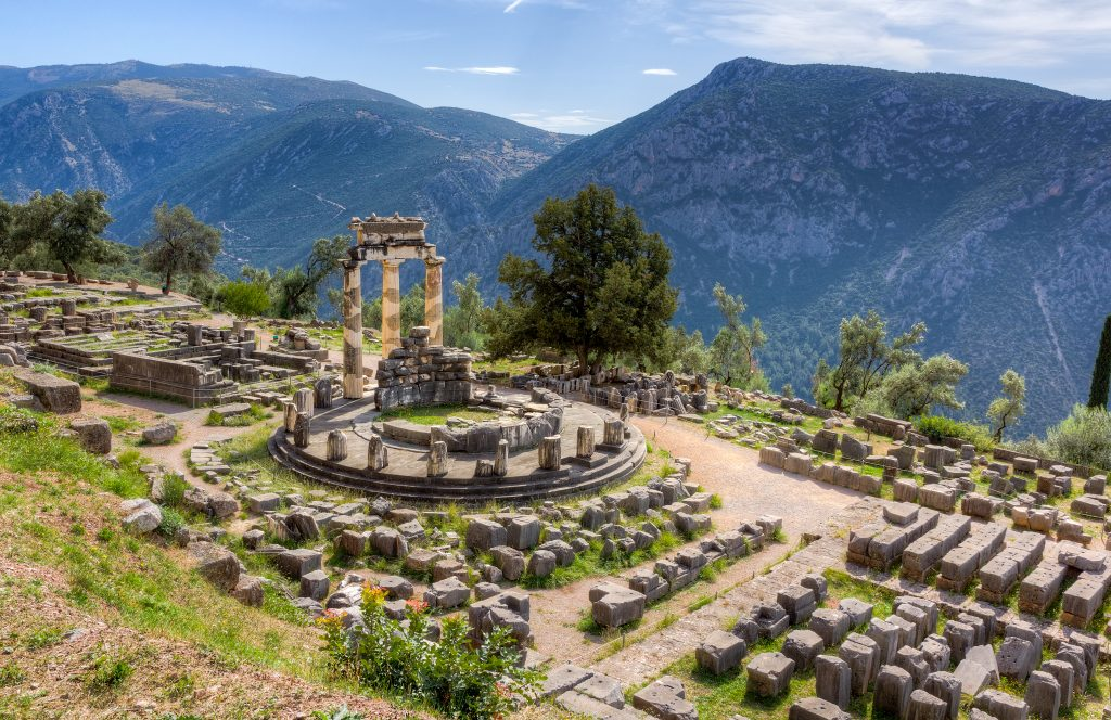 ruins of delphi greece with mountains in the background