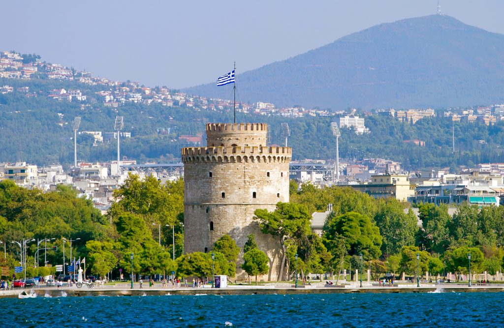 view of stone tower in thessaloniki greece as seen from across the water, a cool stop on a 7 day greece trip