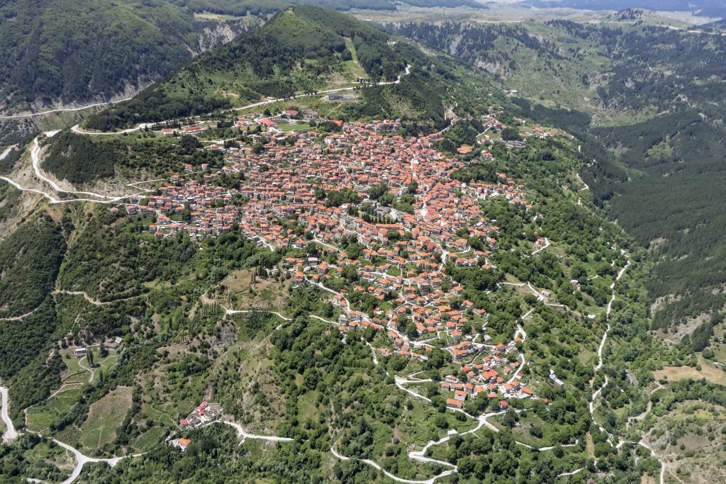aerial view of Metsovo greece with winding mountain roads leading away from it, a hidden gem when visiting greece in 7 days