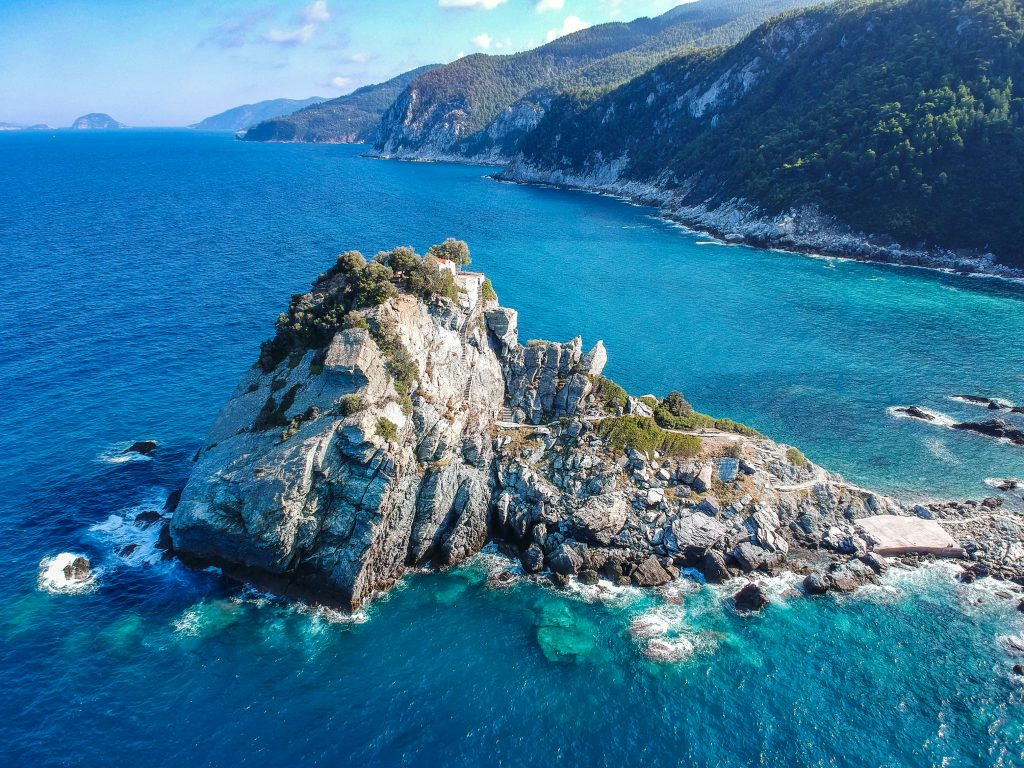 aerial view of mamma mia church in skopelos greece, one of the best places to visit with a 7 day greece itinerary
