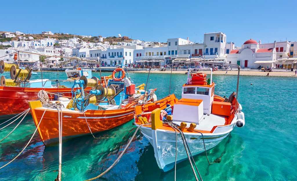 fishing boats in the harbor of mykonos, one of the most popular stops on a greece island hopping itinerary 7 days