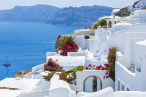 view of whitewashed village on santorini with sea in the background, one of the best itinerary for greece in 7 days travel destinations