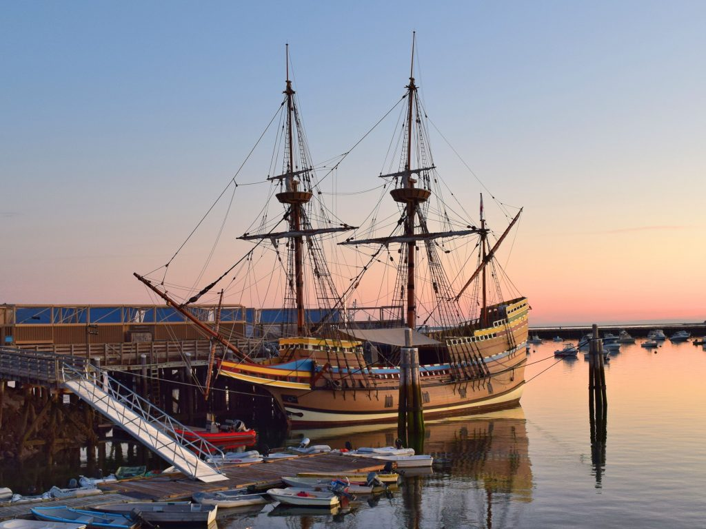 replica of mayflower ship at sunset in plymouth ma, one of the best usa november vacation spots