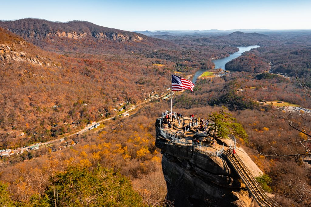 chimney rock near asheville nc with fall foliage, one of the best places to go in november in america