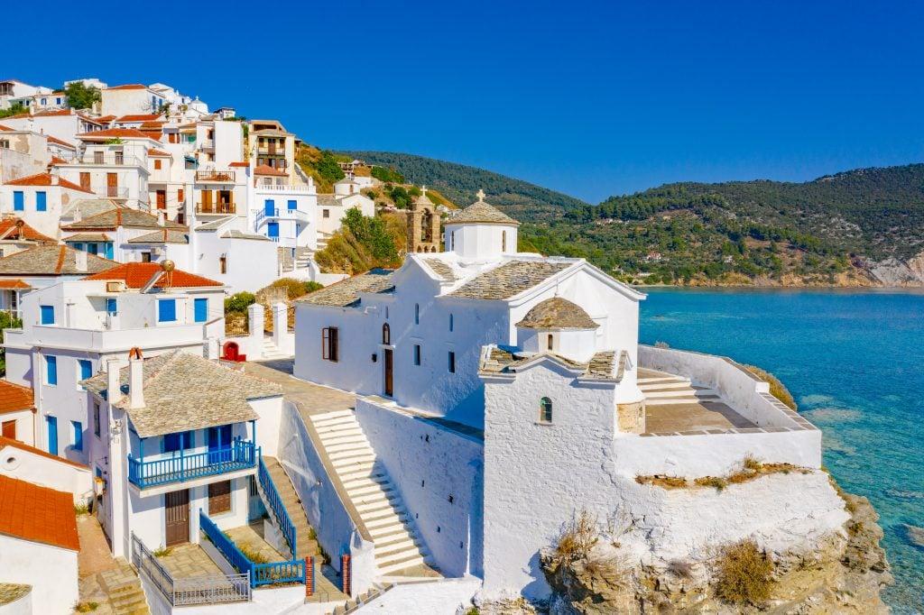 whitewashed village along the water in skopelos greece