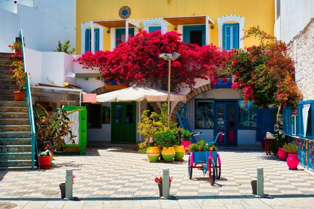 colorful yellow building in adamas greece