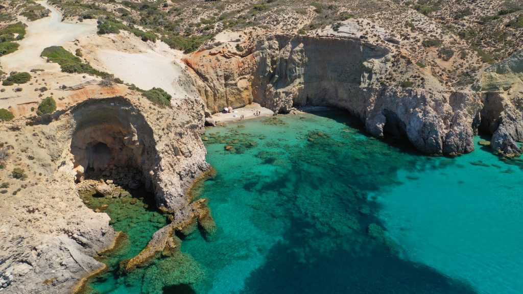 view of rocky cliffs and bright blue water, a fantastic view during an itinerary greece in 7 days