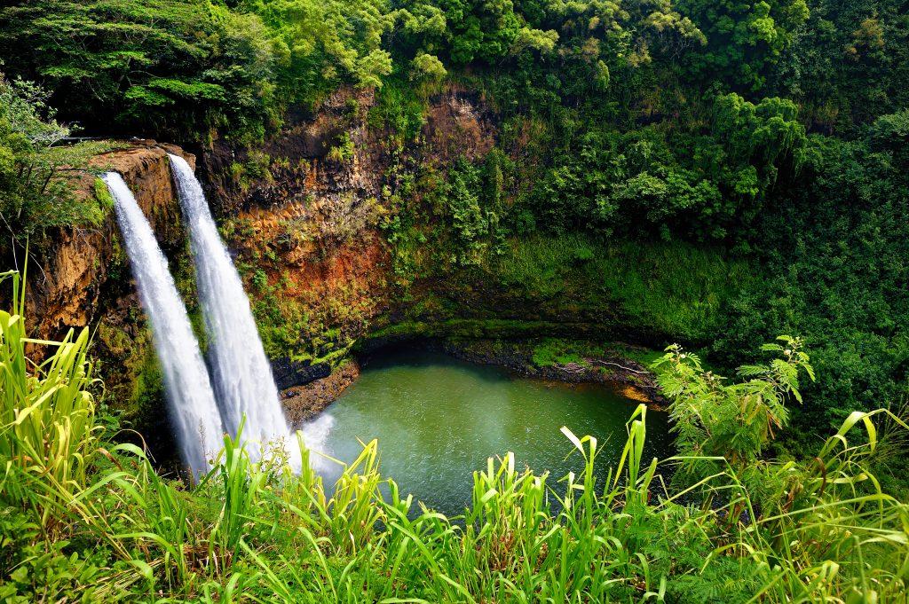 twin waterfalls in forest in kauai hawaii