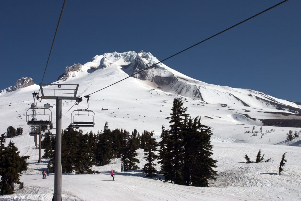 ski lift on a snowy mount hood, one of the best places to go in usa november