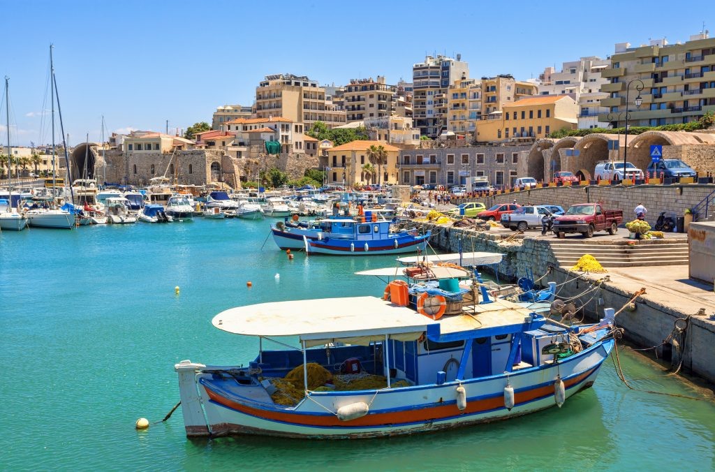 harbor of heraklion greece with city in the background, a fun place to visit during a week in greece crete