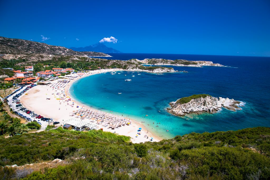 view of busy beach in Halkidiki from above, a fun destination on a greece in 7 days itinerary