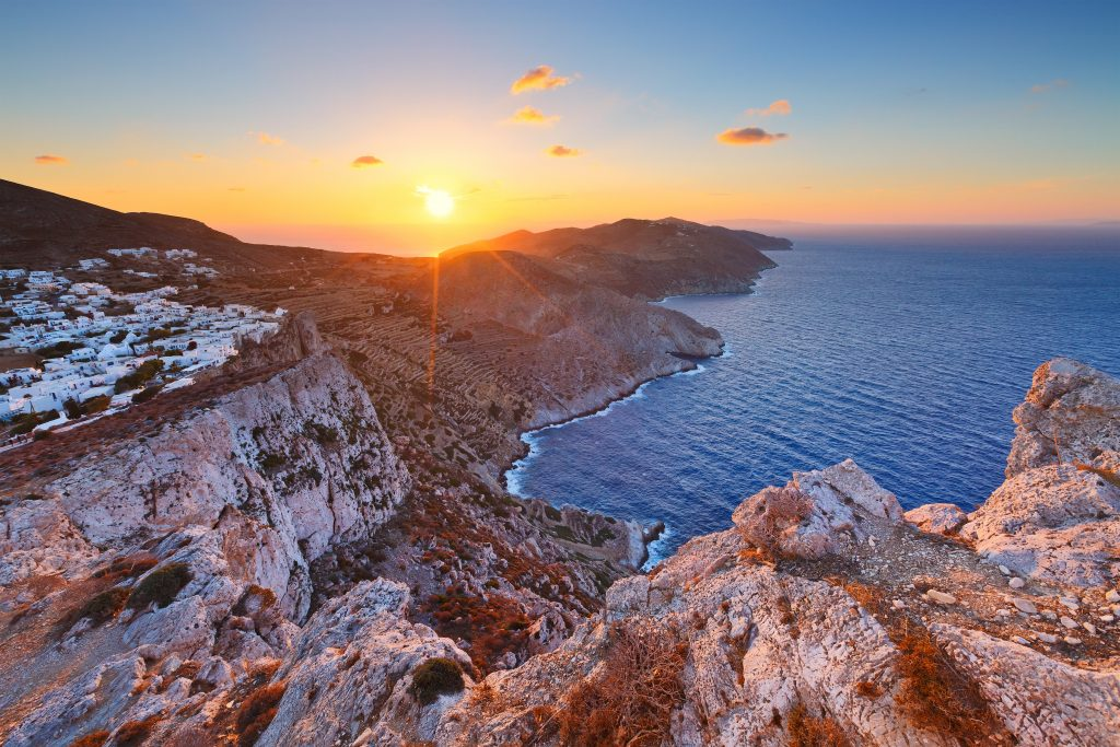 Folegandros village at sunset with the ocean to the right