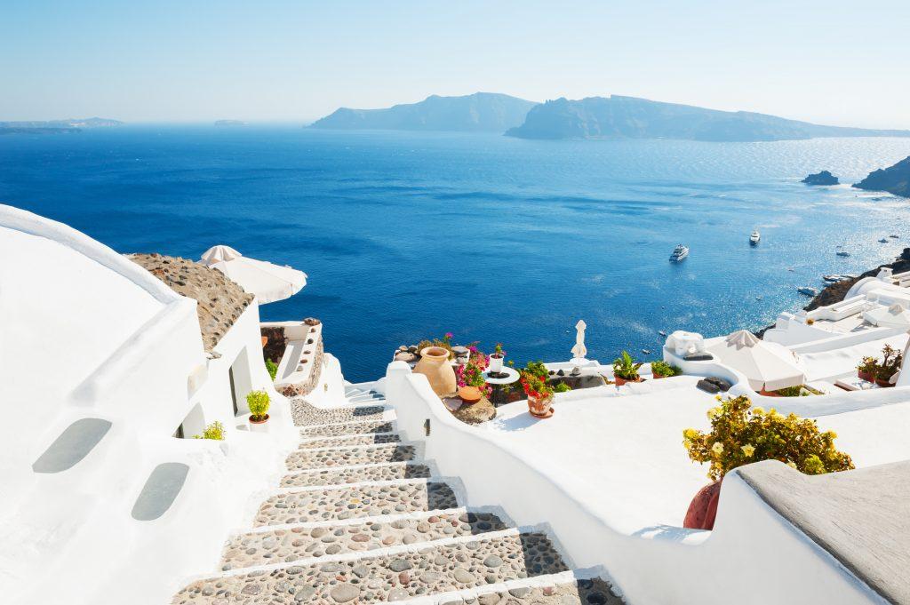 white stairs leading toward the sea santorini