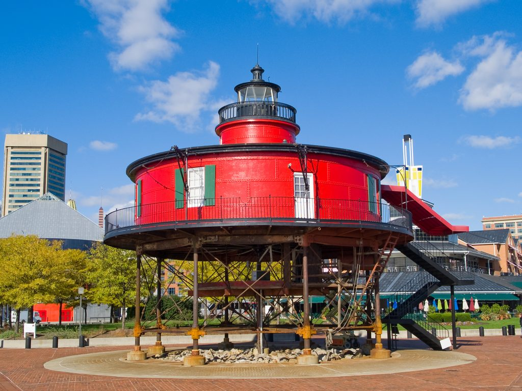 bright red seven foot knoll lighthouse on a sunny day