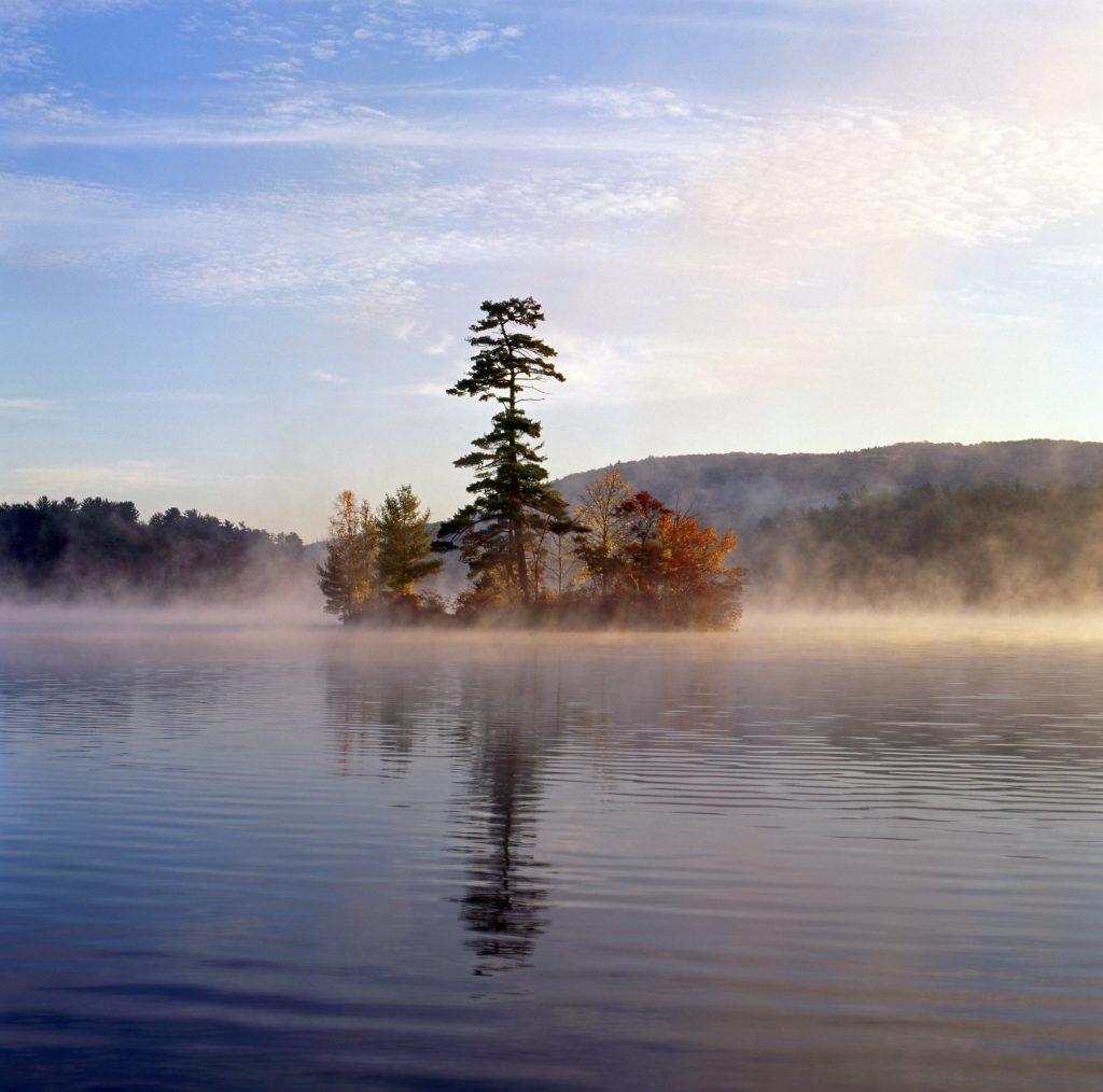 small island with autumn foliage lake george ny with fog