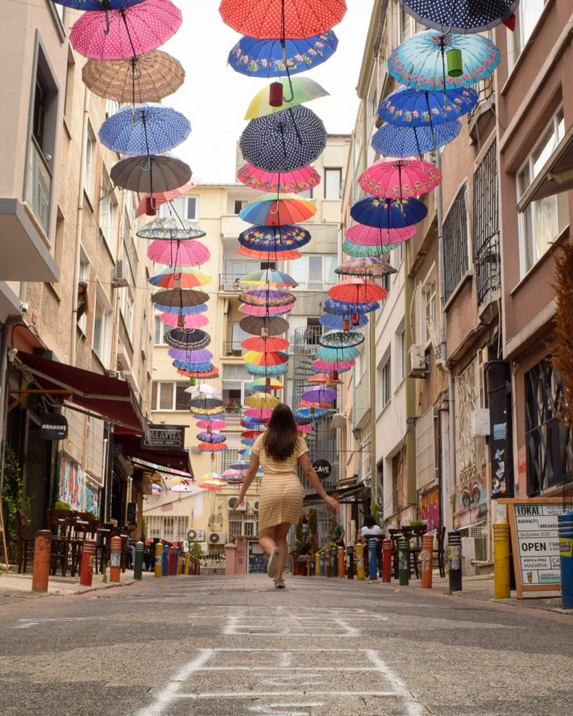 kate storm with a colorful umbrella ceiling in istanbul turkey