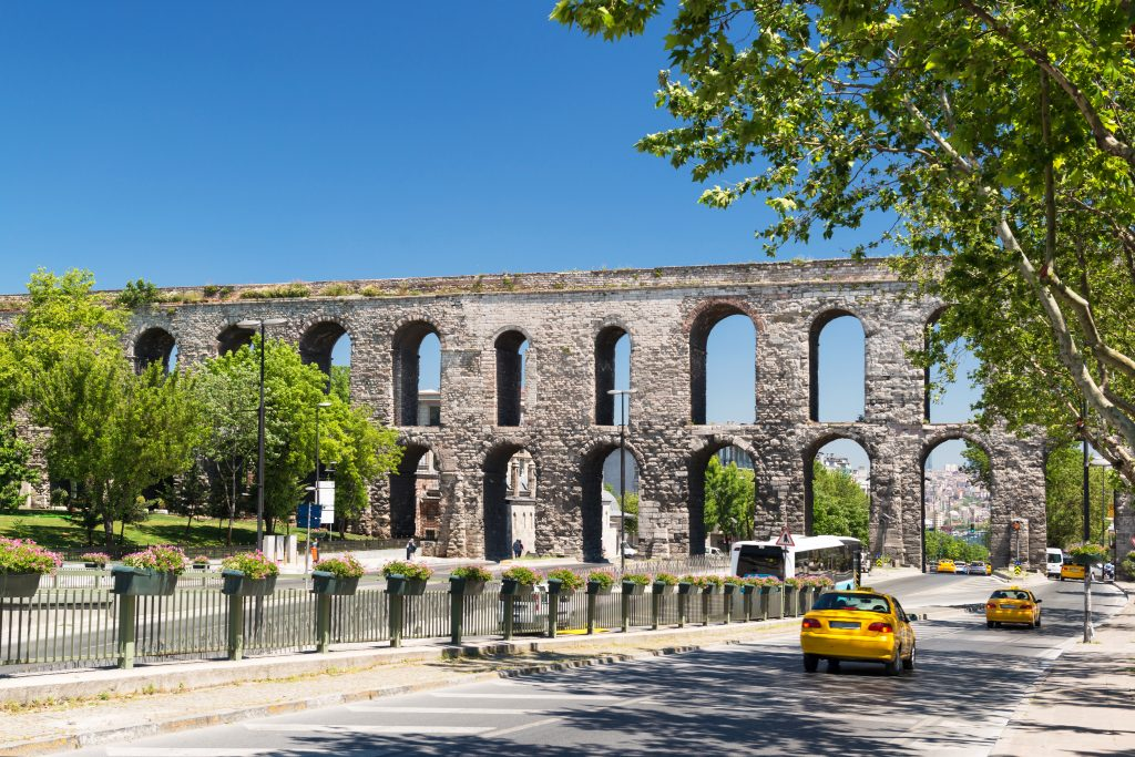 valens aqueduct in istanbul turkey with a taxi in the foreground