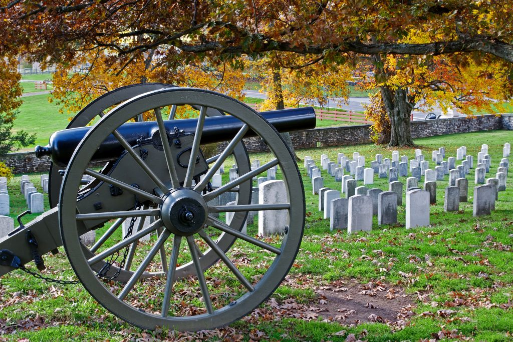 cannon in front of a grouping of headstones in gettysburg national military park
