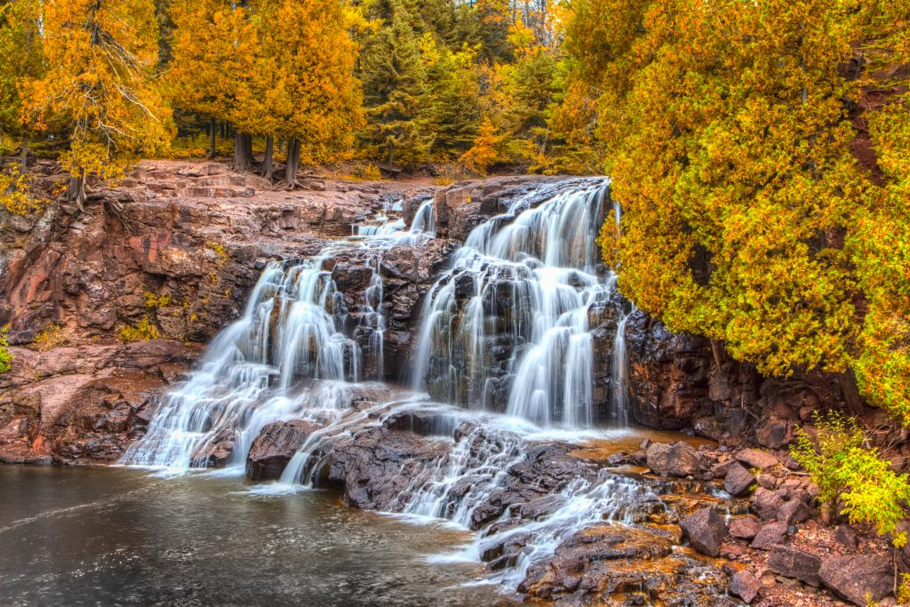 upper gooseberry falls in minnesota during fall foliage season