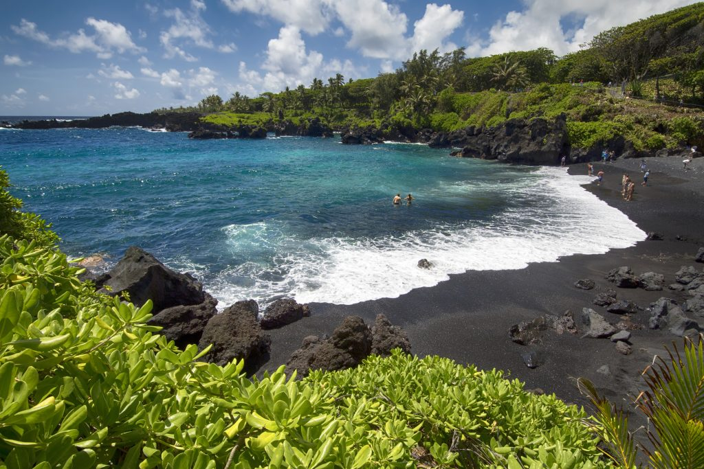 black sand beach in Waianapanapa state park on road to hana maui, one of the best things to do in usa