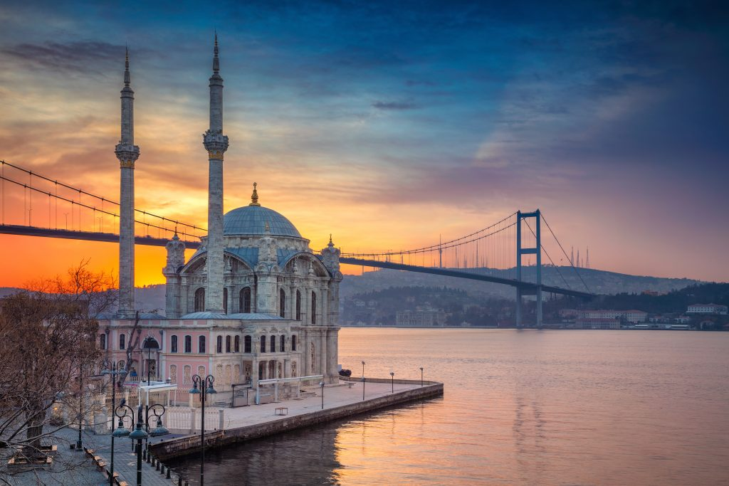 ortakoy mosque at sunset with bridge in the background, one of the best attractions in istanbul turkey