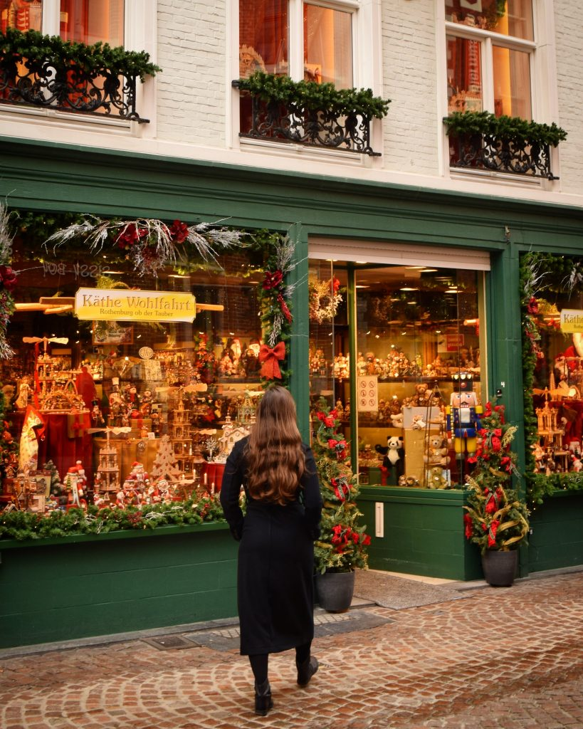 kate storm in front of a christmas store in bruges belgium november